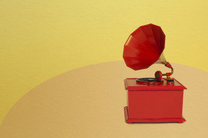 Vintage red color gramophone. Retro plastic toy